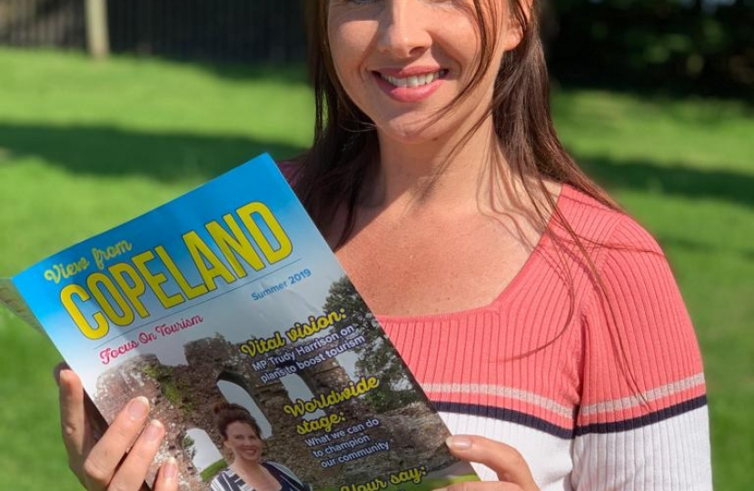 Trudy Harrison Holding Her Tourism Magazine